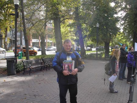"The Halifax Media Co-op's Kendall Worth spoke at the Oct. 17 event about his experiences living in poverty. Here, he is seen selling the ""voice of the poor"" newspaper, Street Feat (Robert Devet photo)."