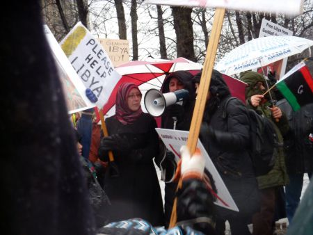 Sixty people stood in the rain to declare solidarity with Libyans fighting for freedom. // photo by Moira Peters