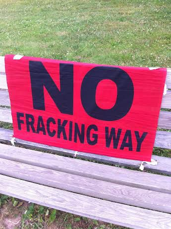 One of several NO FRACKING signs outside the Port Hawkesbury meeting (Photo: Liv Bochenek)