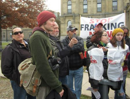 Halifax Media Co-op journalist Miles Howe at an anti-fracking rally.  Howe was arrested three times while covering shale gas protests in New Brunswick.  All charges have now been dropped.  Photo: Patty Crow