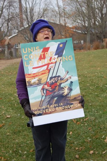 """One Acadian demonstrator displayed the Edward Kwong poster, United Against Fracking, """"In Solidarity With New Brunswick"""""""