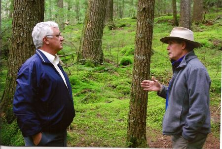 Jim Dresher, sustainable woodlot operator, discusses forestry with Nova Scotia's Minister of the Environment Sterling Belliveau in 2009. The minister spoke at NSEN's 2009 AFG, held at Dresher's Windhorse Farm.