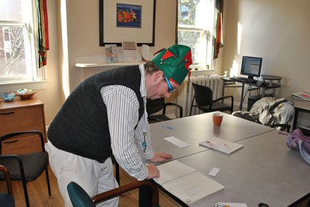 Allistair Fraser shows off his skecthbook at the Nova Scotia Austism Centre