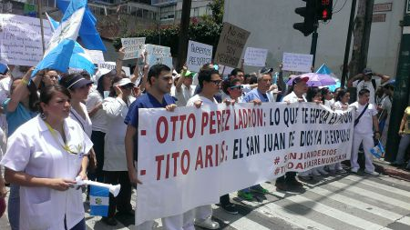 Nurses and Doctors March in the National Strike: Otto Perez Thief - Jail is Waiting for You. Tito Arias - You're Not Welcome in Our Hospital