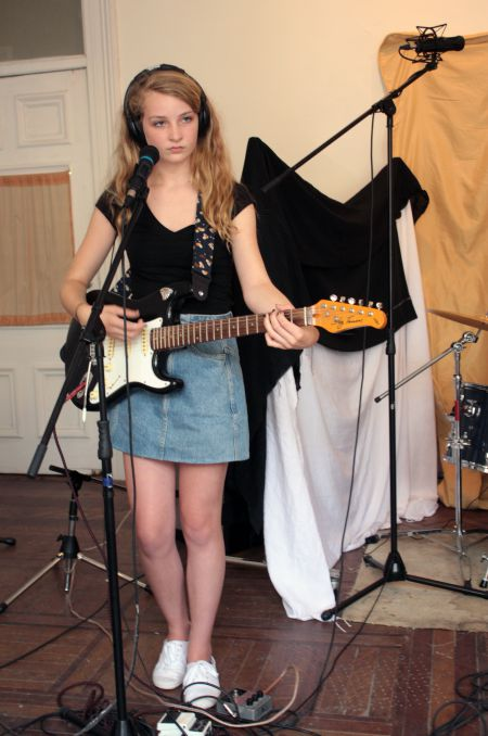 A girl records a song at the Rebel Girl Rock Camp. (Photo by Hilary Beaumont)