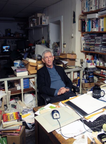 Ken-Porter, owner of the K-PC computer computer company, sits at his desk inside his Agricola Street building. (Photo by Hilary Beaumont)