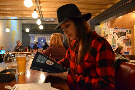 Books and beer – has there ever been a better combo? The Good Robot Brewing Company is inviting its patrons to bring their books to the bar once a month for their two-hour silent reading event. [Photo: Craig Muise]