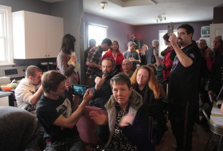 About 25 people crammed into the tiny room to hear the press conference. (Photo by Hilary Beaumont.)
