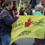 Members of The Council of Canadians add their support to the march