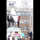 Protesters shroud the statue of Cornwallis as the Harper effigy looks on...