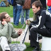 A CKDU and Halifax Media Co-op journalist interviews a protester