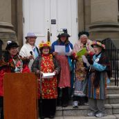 The Raging Grannies singing at the rally