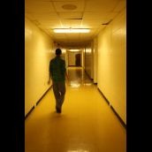 Former St. Pat's student Kadeem Hinch walks through the empty hallways of his old school. It's summer vacation.