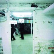 Province House: Unidentified people, probably an insurance representative and engineer, inspect the basement. (Photo: Courtesy of the province)