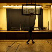 Hinch walks across the creaky floor of the St. Pat's gym. He remembers how much effort the school put into presenting Christmas plays on this stage every year.