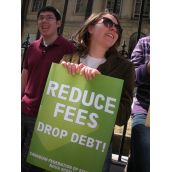 "Students yelled ""Fuck high fees"" and held signs saying ""Reduce Fees, Drop Debt"""