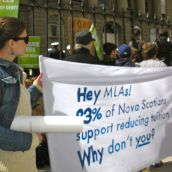 "Sign reads: ""Hey MLAS: 83% of Nova Scotians support reducing tuition fees. Why don't you?"""