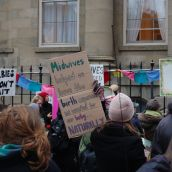 About 200 people from across the province rallied in Halifax this afternoon, demanding access to midwifery services. The province's current legislation limits the number of midwives that can legally practice in N.S, and confines midwives to three 'model sites' chosen by the province.