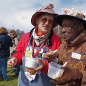 Norma Scott and Ina Kelson of Halifax's Raging Grannies eat free locally produced veggies to protest corporate control of food.