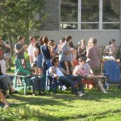 Community members mingle and share food provided by Campus Action on Food.