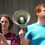 Palmira Boutlier and Kyle Buott hold the megaphone to Miles Howe, reporting via Skype.