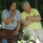 Alma Brooks of St. Mary's First Nation and Vicki Oland of Durham Bridge chat at the blockade of seismic vibrators in Stanley, NB. Photo: Tracy Glynn.