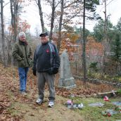Dan and Steven Jollimore at the family plot in the cemetery that they believe got damaged during road construction.  Photo Robert Devet