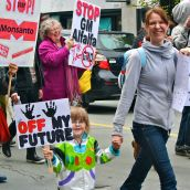 Lisa Smith (right) and Vella Smith participate in the march, which was attended by many children whose families were enraged by the lack of choice given to consumers when it comes to the labelling of GMOs.