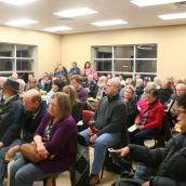 Major cuts at Canada Post and the implementation of community mail boxes had not just postal workers upset. Rallies and town hall meetings, like this one in Dartmouth in January, were held throughout the year.  Photo Robert Devet