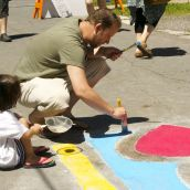 Mark and his daughter Morgan painting the mural in their neighborhood.
