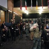 The assembled media faces...