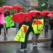 "About 50 people braved a steady rain in early June and gathered on the Grand Parade in downtown Halifax to voice their concerns about a new federal prostitution bill.  The legislation claims to target ""johns"" and ""pimps"", but sex workers say that it makes things worse for them.  Photo Robert Devet"