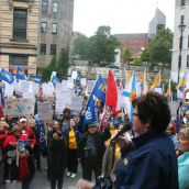 Joan Jessome, president of the NSGEU, addresses the crowd from the steps of Province House. Photo Robert Devet