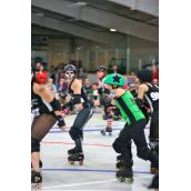 """""""Punchie Bruiser"""" trying to break through the pack of skaters"""