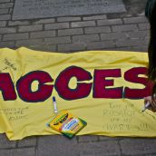 The banner that supporters took turns writing messages of choice