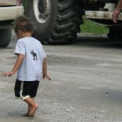 A child walks past the seismic truck blockade in Stanley, NB on August 9, 2011. Photo: Tracy Glynn.