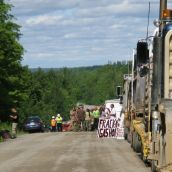 Residents of Stanley and supporters from as far away as northeastern New Brunswick block seismic vibrators upon discovering their activity on roads in Stanley, NB. Photo: Tracy Glynn.