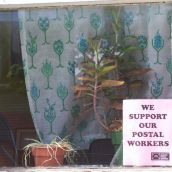 """Other posters read """"Maternity Leave:  Brought to you by Striking Postal Workers."""""""