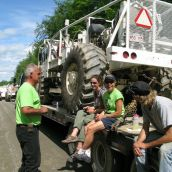 Penniac anti-shale gas protesters sit on a tow truck carrying a seismic vibrator truck. Photo: Tracy Glynn.