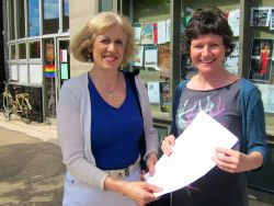 Megan Leslie, M.P. for Halifax receiving petition from Joanne Light, Citizens' Climate Lobby Halifax, demanding the government act deeply and broadly on climate change