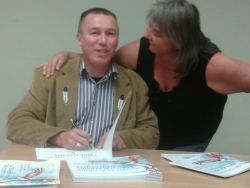 Michael James Issac signs copies of his new book, The Lost Teachings / Panuijkatasikl Kina'masuti'l [Photo: S. Barber]