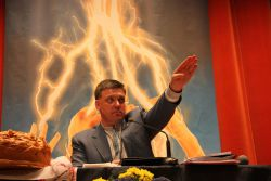 Svoboda's Oleh Tyahnybok doing their party salute when re-elected their leader. Photo GlobalResearch.ca