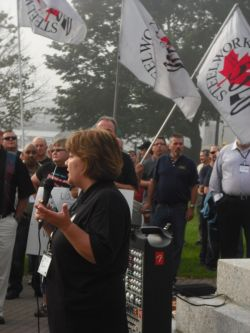 Kim Power speaks to the demonstration.