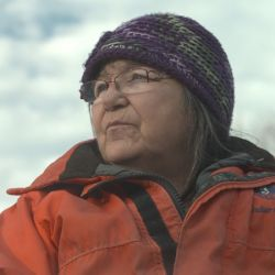 Maliseet elder Alma Brooks on the banks of the Wulustuk (Saint John) River. Photo: Jonathan Hayes, Director of Take Me To The River