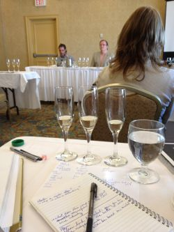 One of these things is not like the others, though they are also remarkably the same... Traditional Method Master Class at Canada's Best Sommelier competition in Halifax this week. Photo by Moira on Jeff Pinhey's camera. Jean-Benoit Deslauriers and Peter Gamble in the background.