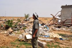 Jaber Rjila, whose land has thrice suffered major Israeli army invasions, killing nearly all of his 3000 chickens, razing hundreds of olive, fruit and nut trees, pock-marking the house walls with machine gun fire, destroying the chicken barn and appliances, and stored crops within, and traumatizing his 7 young children. Not on Dexter's NS-Israel trade mission. Photo: Eva Bartlett