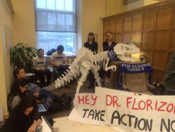 "The ""FOIPOPasaurus"" and student protestors within President Florizone's office."
