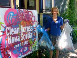 Volunteer Kiki Woods poses in front of one of the Clean Across Nova Scotia bases on Robie Street (photo Natascia Lypny).