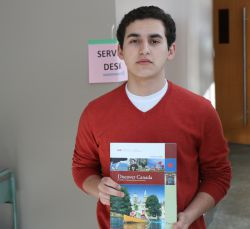 Yazan Khader, a 'New Canadian' citizen originally from Palestine, holds a copy of 'Discover Canada', the study guide from which the department of Citizenship and Immigration will determine if you 'know' what it is to be Canadian. [Photo: Miles Howe]