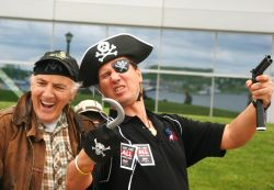 Two scurvy sea-dogs outside of Emera headquarters in Halifax. [Photo: Miles Howe]
